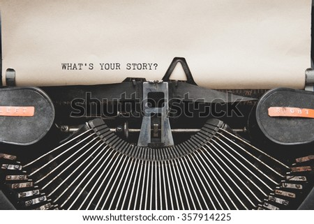 Antique typewriter with aged textured paper sheet. Space for your text - stock photo