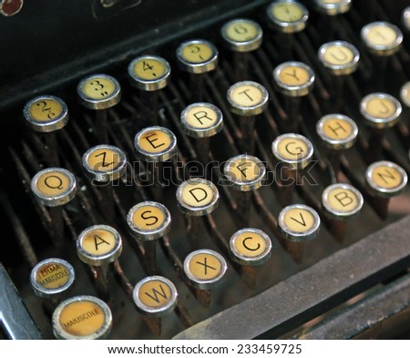 antique typewriter with yellow keys - stock photo
