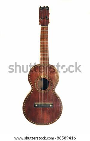 antique ukulele with decorative inlay - stock photo