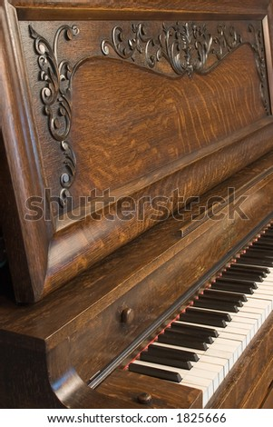 Antique Upright Piano - stock photo
