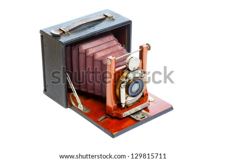 Antique view camera with leather bellows isolated on a white background - stock photo