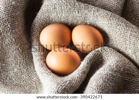 antique village still life with chicen eggs on burlap