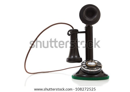 antique, vintage candlestick telephone on a white background - stock photo
