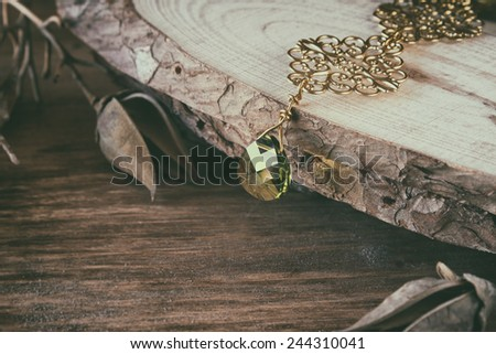 antique vintage necklace on wooden table. retro filtered image - stock photo