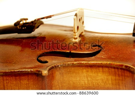 Antique Violin fiddle with focus on f-hole - stock photo