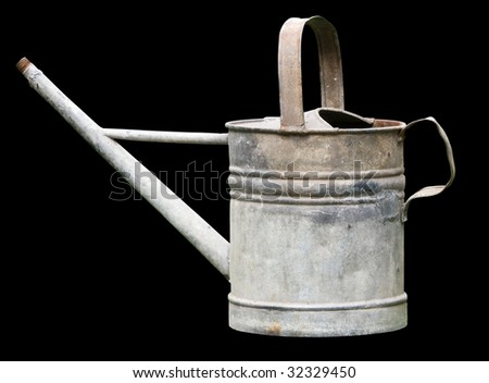 antique watering can - stock photo