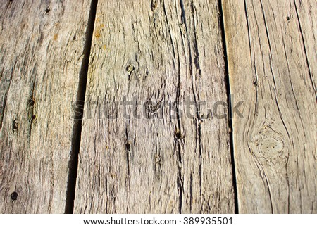 antique weathered barn wood background with knots and nail holes, wood floor