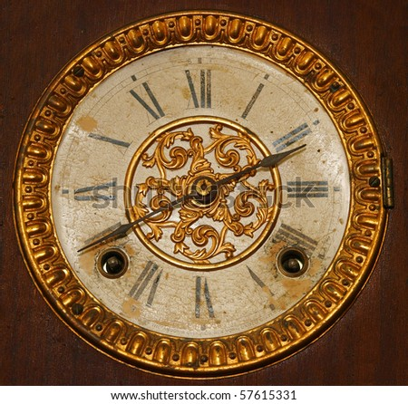 Antique Wind Up Clock Face with Roman Numerals - stock photo