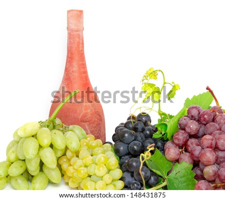 antique wine bottle soil and grapes isolated on white background  - stock photo