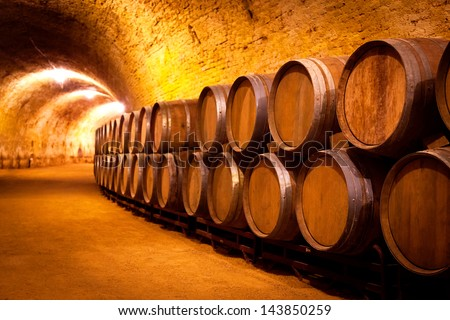 Antique Wine Cellar with Rusty Wooden Barrels - stock photo