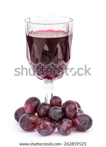 Antique wineglass with red grapes on white background - stock photo