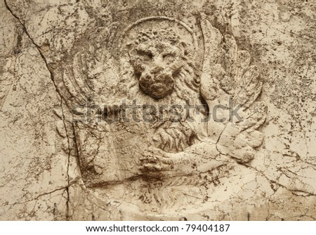 antique winged lion relief in marble, Venice - stock photo
