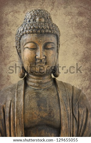 Antique wood carving of Buddha, very shallow depth of field with focus on eyes; placed on sepia marbled background. - stock photo