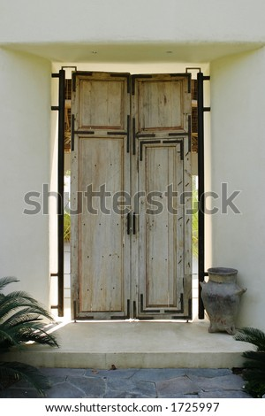 Antique wood front door for a Mexican house - stock photo