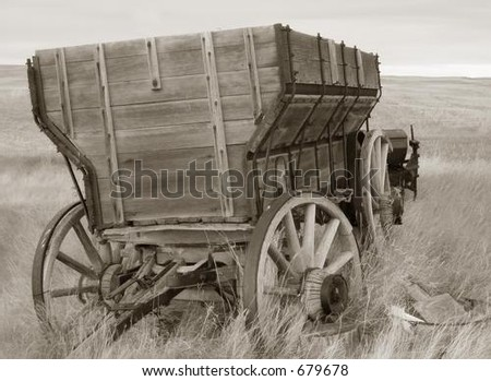 antique wood wagon in sepia tones - stock photo