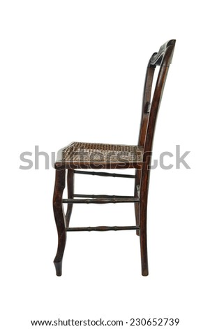 Antique wooden chair with cane isolated on white - side view