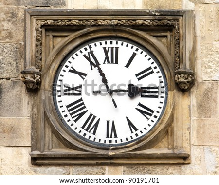 Antique wooden clock with roman numbers. - stock photo