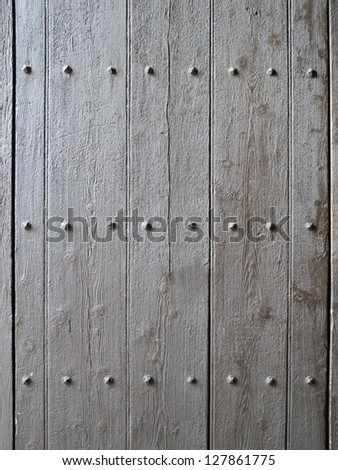 antique wooden door detail with nails background - stock photo