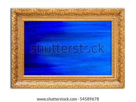 Antique wooden gold frame, intricately carved, with a blue abstract painting. - stock photo