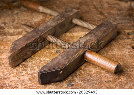 Antique wooden hand screw clamp - stock photo