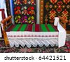 antique wooden handmade bed and old carpets - stock photo