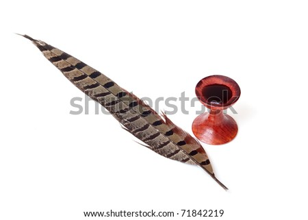 antique wooden inkwell and  feather pen on a white background - stock photo