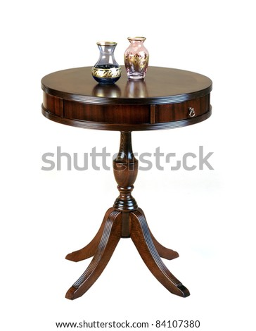 antique wooden round table isolated on white - stock photo