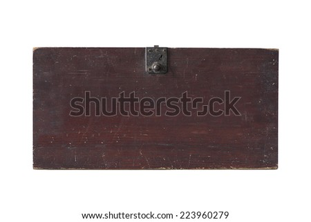 Antique wooden santa on wooden table - stock photo