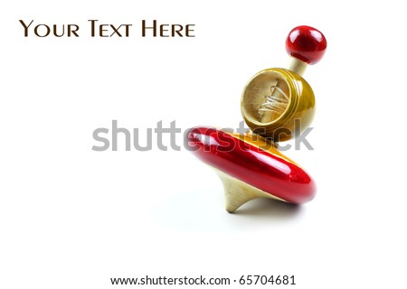 Antique wooden shiny spinning top on white background - stock photo