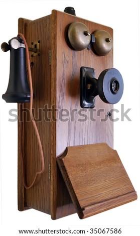 Antique wooden telephone isolated on white - stock photo