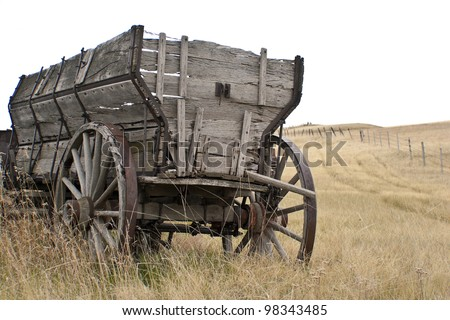 Antique wooden wagon  on the  prairie - stock photo