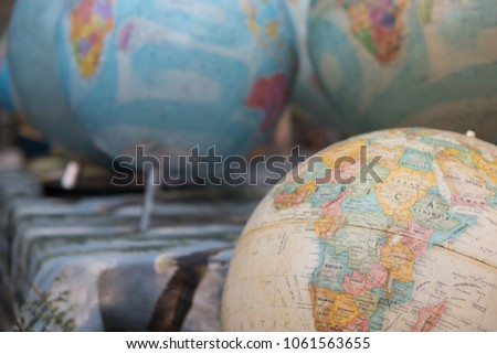 Educational world map stock images royalty free images vectors antique world globes at an outdoor flea market one tan antique globe in foreground and gumiabroncs Image collections