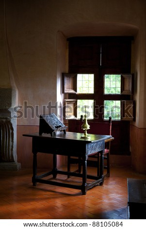 Antique writing desk in a rural interior - stock photo