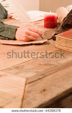 Antique writting objects at wooden desk - stock photo