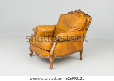 antique yellow colour leather armchair