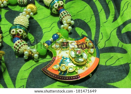antiques pendant with stone (isolated on a Green Texture Background) - stock photo