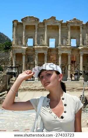 Antiquity greek city - Ephesus.  Pretty traveler on background of First Library - stock photo