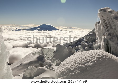 Antisana volcano seen from the glaciers of Cotopaxi volcano, Andes, Ecuador - stock photo