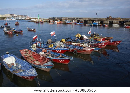 ANTOFAGASTA, CHILE - MAY 16, 2016: Colourful fishing boats in the harbour of Antofagasta on the Pacific coast of Chile. - stock photo