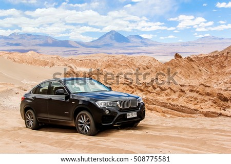 ANTOFAGASTA, CHILE - NOVEMBER 15, 2015: Modern black crossover BMW X4 xDrive 2.8i (F26) in the Valle de la Muerte (Mars Valley) in the Atacama Desert.
