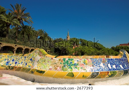 Antoni Gaudi hause and ceramic bench in Park Guell, Barcelona, Spain - stock photo