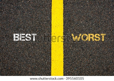 Antonym concept of BEST versus WORST written over tarmac, road marking yellow paint separating line between words - stock photo