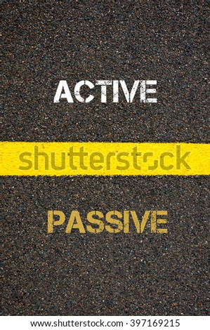 Antonym decision concept of PASSIVE versus ACTIVE written over tarmac, road marking yellow paint separating line between words
