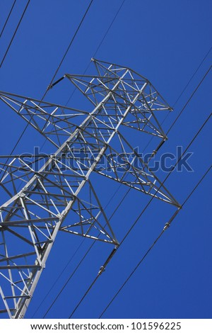 ants eye view of electric tower and cables - stock photo