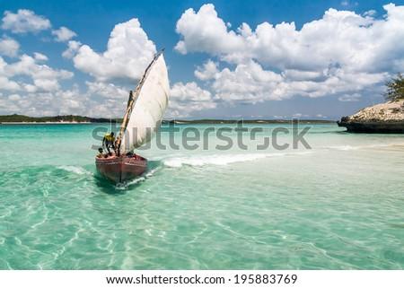 ANTSIRANANA, MADAGASCAR - NOV 19: Unidentified fishermen in a traditional fishing boat in the Emerald Sea of Antsiranana (Diego Suarez), north of Madagascar, on nov 19, 2008 - stock photo