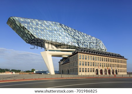 ANTWERP-AUG. 13, 2017. Port of Antwerp headquarters, design Zaha Hadid, former fire station with a massive sculpture on top with diamond shaped glass, tribute to trade for which the city is renowned.