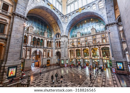 ANTWERP, BELGIIUM - SEPTEMBER 03, 2015: hall of the historical main station with unidentified people. Constructed 1895 - 1905 it is widely regarded as finest example of railway architecture in Belgium - stock photo