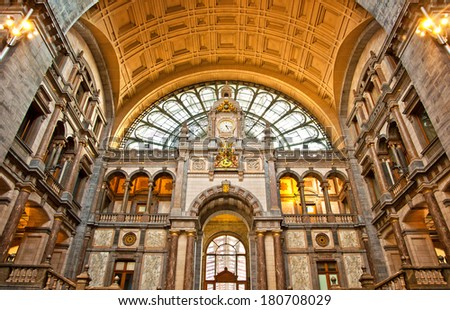 ANTWERP, BELGIUM - APRIL 21:Famous clock on the facade of the old beautiful railway station in Antwerp. Belgium, also known as the cathedral amongst stations on April 21, 2013 in Antwerp, Belgium.  - stock photo