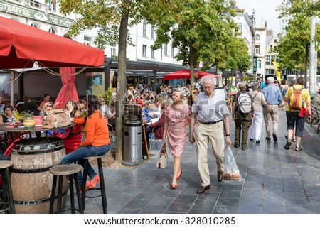 ANTWERP, BELGIUM - AUG 11: Lounging people and relaxing tourists at terraces downtown in the city Antwerp on August 11, 2015 in Antwerp, Belgium