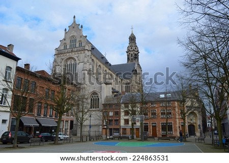 ANTWERP, BELGIUM, MARCH 5, 2014: Detail of one of the many street basketball courts with a magnificient church behind it in antwerp. - stock photo